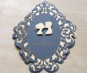 Straight on photograph of Lovers Cameo laser cut wedding invitations