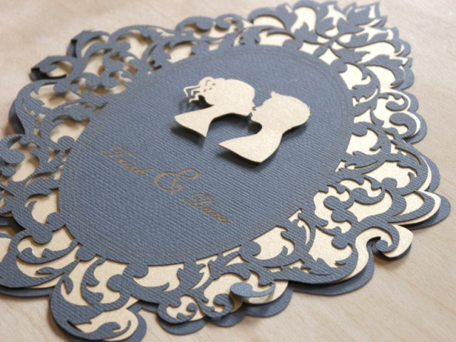 Detail of Lovers Cameo laser cut wedding invitations