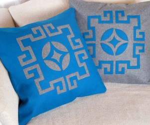 Laser cut throw pillows in blue and gray