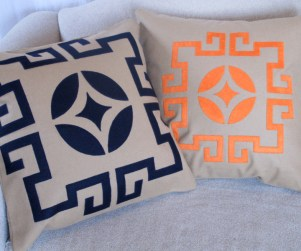 Laser cut throw pillows in navy blue and orange