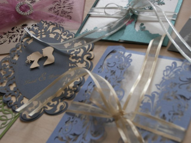 laser cut wedding invitations in different colours and styles