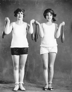 two woman holding weights