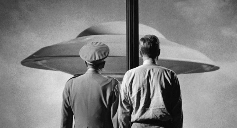 two men and flying saucer