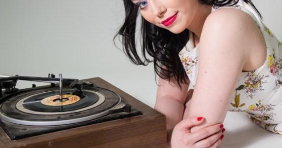 stock-photo-rock-music-vintage-girl-retro-record-vinyl-bands-listening-d0e02478-33d6-461f-8b63-adb2a88202c2