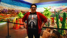 "Justin Favela, 30 year old artist from Las Vegas poses in front of his exhibit ""Fridalandia"""