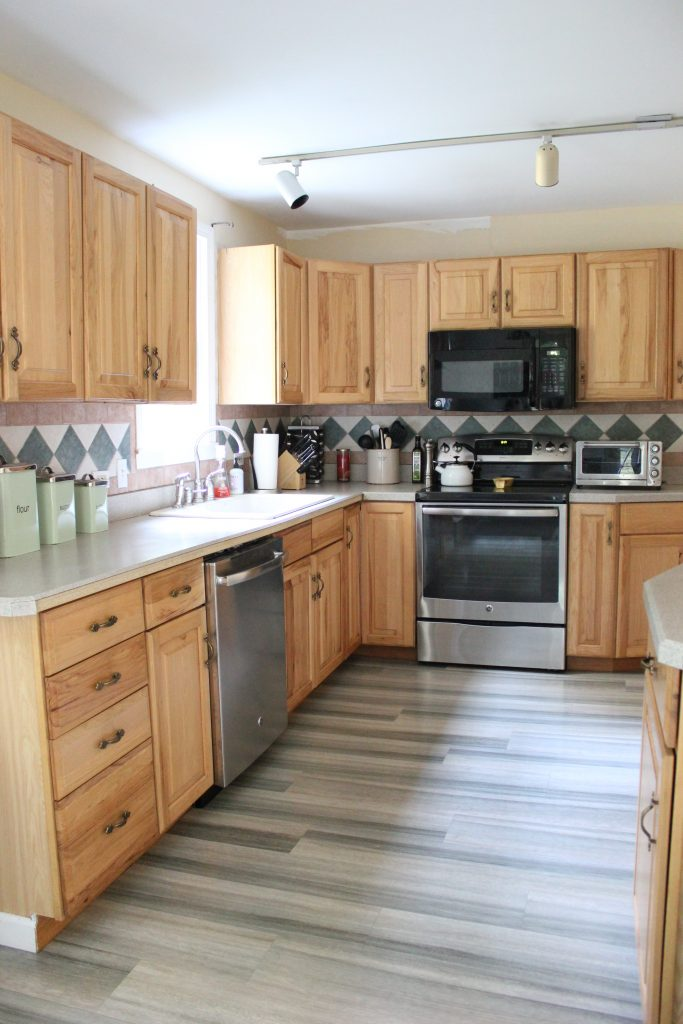 Top 28 pergo flooring cabinets lowes hand scraped for Flooring before cabinets