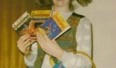 An overly excited girl holding three Goosebumps books. Gersberms mah fravrit berks.