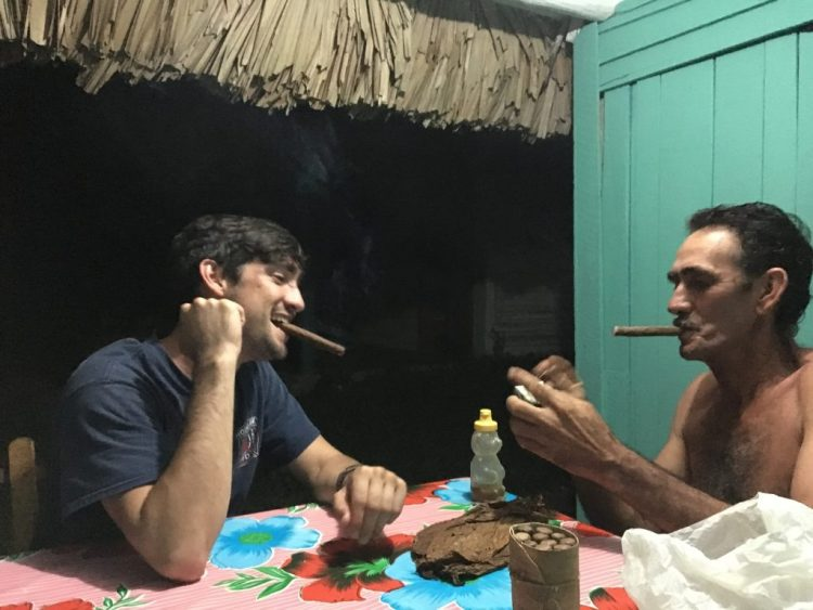 My son Ben sharing a cigar and a laugh with the farmer who was our host in Vinales, Cuba.