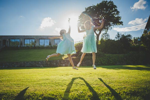 Lewis-Fackrell_photography-Cardiff-South-Wales-Wedding-Photographer-Canada-Lake-Lodge-Cerian-Dan-bridesmaids-playing-new-apartment-sun-beam