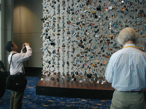 "ALA Delegates Stop to Admire ""Made in China,"" a work by Patrick Miceli, featuring 10,000 souvenirs of Chicago suspended on cables"