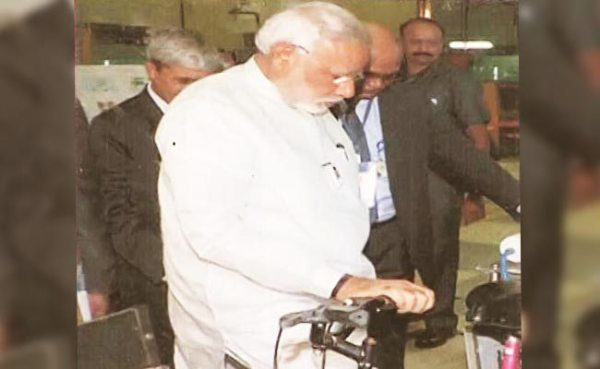 Prime Minister Narendra Modi, during his visit to the centre, examines the cycle fitted with a water purifier.