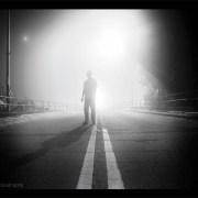 misty night on a bridge - bw