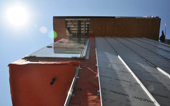 looking up - zinc siding panels on modern house