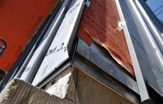 zinc siding detail on modern infill house