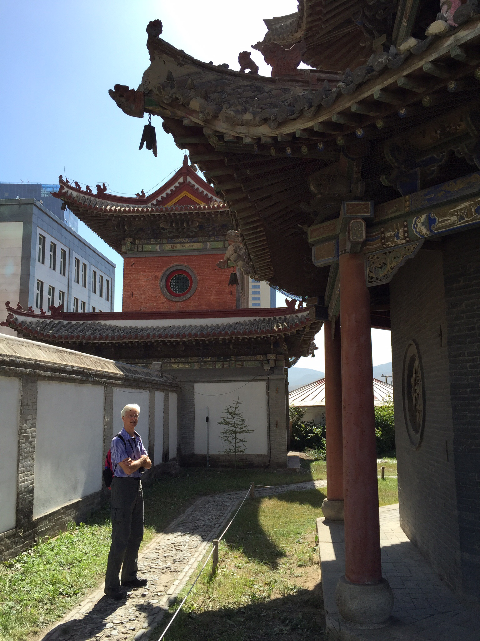 Not all of the displays were in the main temple. There were several smaller temples that housed additional displays. Here Steve stands outside one of those buildings. It was not open before we arrived; one of the women managing the displays rushed to open it for us.