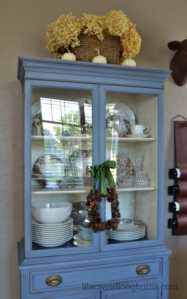 blue hutch with fall decor