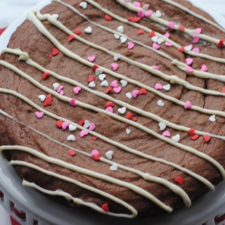 Brownie Cake Drizzled with White Chocolate and Heart Sprinkles