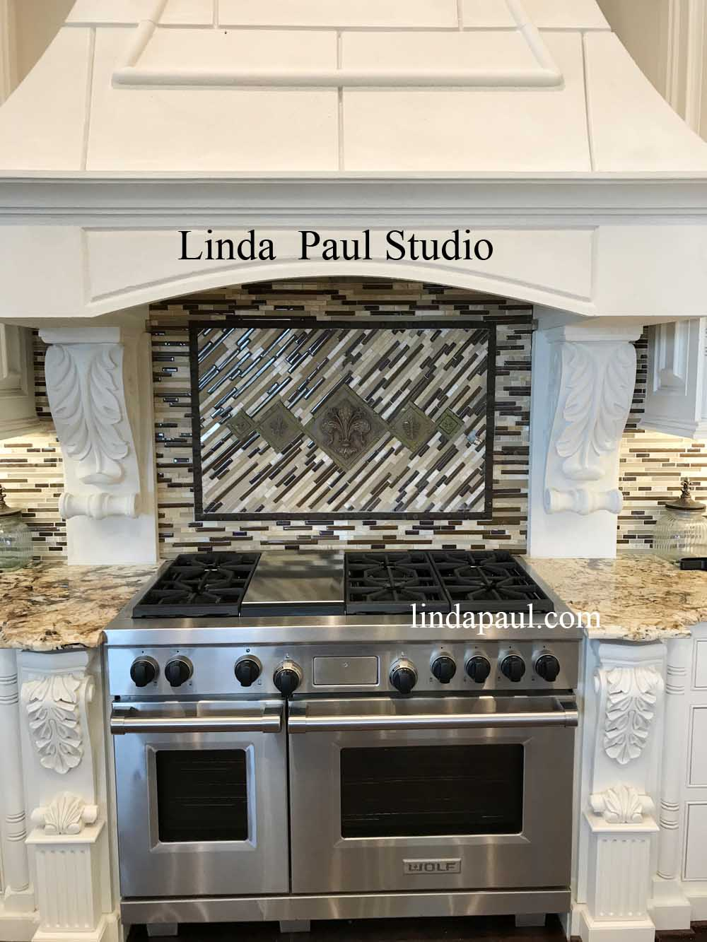 mosaic stick tile backsplash with 5 fleur de lis metal design from Linda Paul Studio 1000