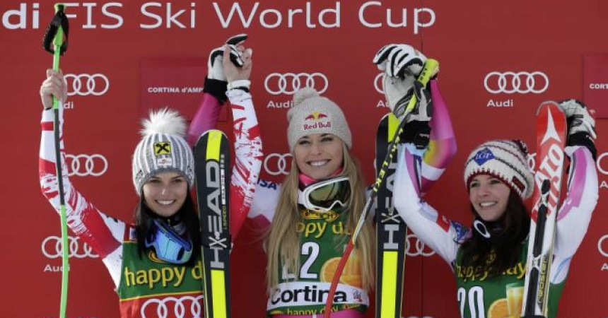 Lindsey Vonn (C) of the U.S. celebrates on the podium with second placed Anna Fenninger of Austria (L) and third placed Tina Weirather of Liechtenstein (R) after winning the women's World Cup Super-G skiing race in Cortina D'Ampezzo January 19, 2015. Vonn became the most successful female in Alpine skiing World Cup history when she won a Super-G on Monday, her 63rd victory in the competition.   REUTERS/Max Rossi (ITALY - Tags: SPORT SKIING)