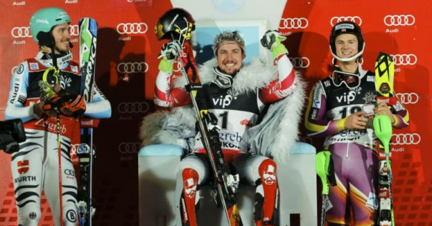 Marcel Hirscher of Austria is flanked by Germany's second placer Felix Neureuther (L) and Norway's third placer Sebastian-Foss Solevaag after winning the men's slalom at the Alpine Skiing World Cup in Zagreb January 6, 2015.                 REUTERS/Antonio Bronic (CROATIA  - Tags: SPORT SKIING)