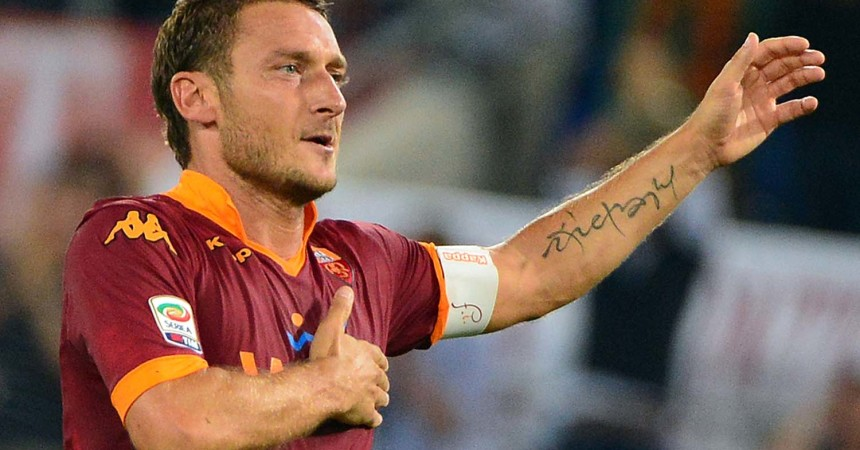 AS Roma's forward Francesco Totti celebrates after scoring a goal during the Italian Serie A football match between AS Roma and Sampdoria on September 26, 2012 at the Olympic stadium in Rome.  AFP PHOTO / GABRIEL BOUYS        (Photo credit should read GABRIEL BOUYS/AFP/GettyImages)