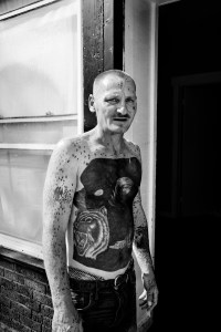 © PAOLO PELLEGRIN/MAGNUM PHOTOS, A tattooed man in Northeast Rochester. Rochester, NY. U.S.A. 2012