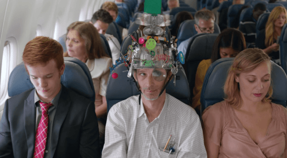 Airline passenger wearing computer device on head