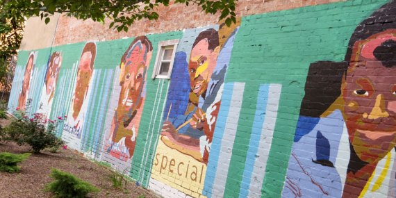 Columbus Multi-cultural mural on red brick side of building