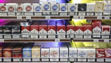 epa02436701 View of cigarette boxes in a tobacconist in Paris, France, 08 November 2010. The price of tobacco rose 6 percent in France, meaning the cheapest cigarettes will now cost 5.40 euro (7.51 US dollars).  EPA/LUCAS DOLEGA