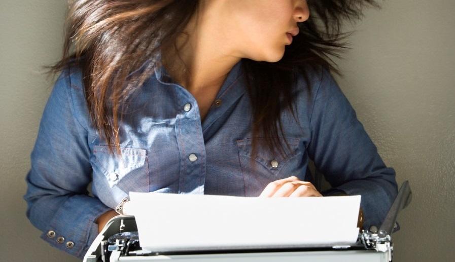 Woman Using Typewriter copped
