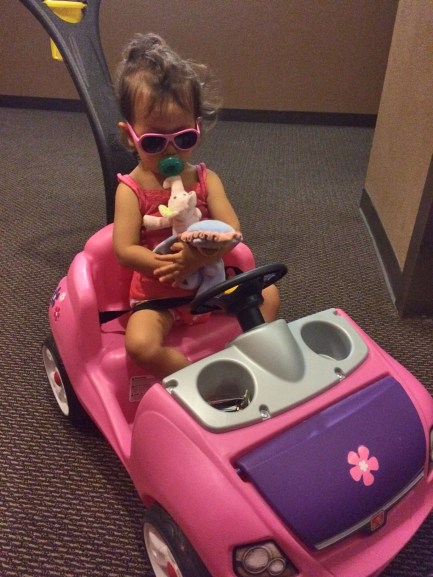 Ride pink car? Sunglasses?