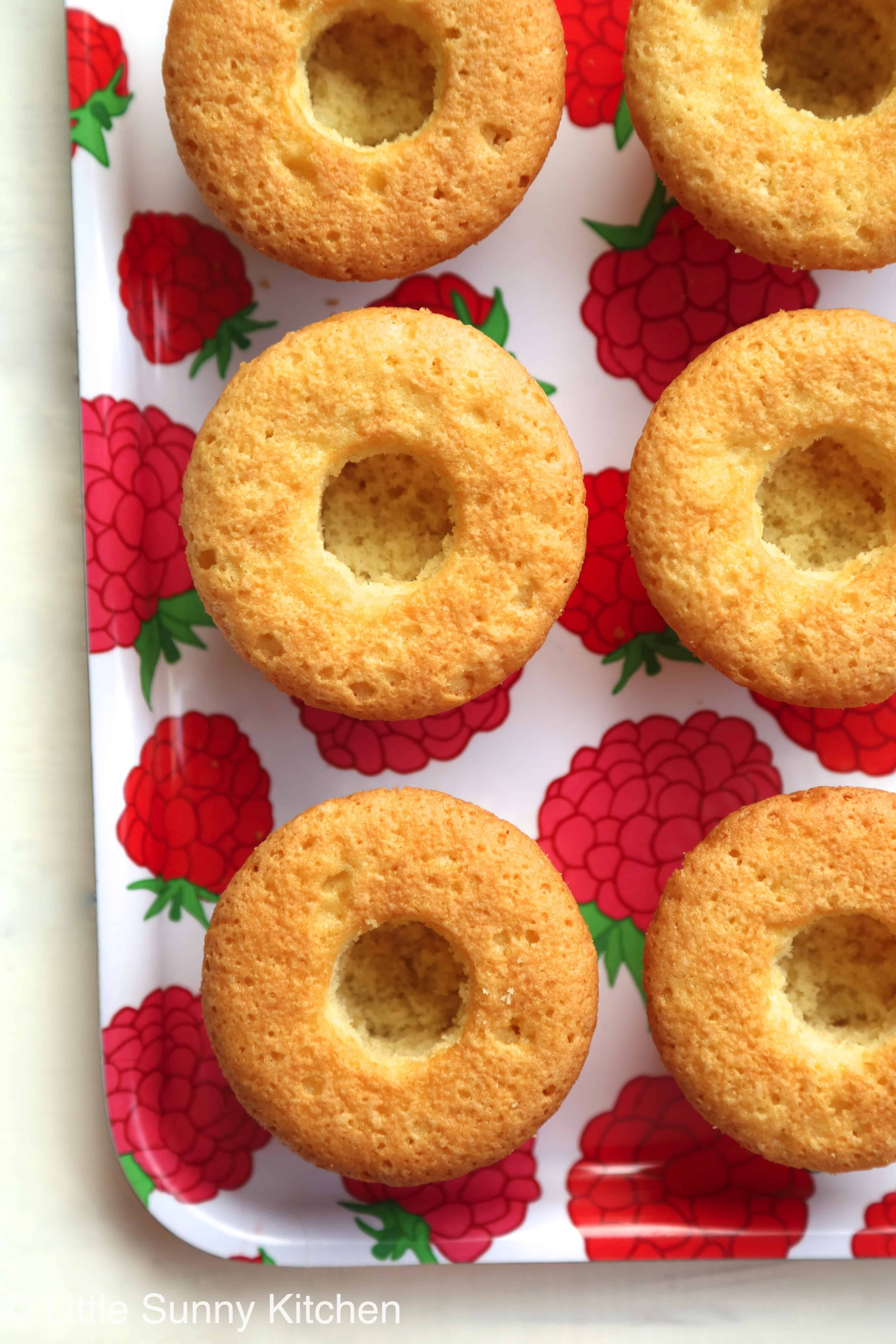 Soft, fluffy vanilla cupcakes filled with fresh strawberry jam and ...