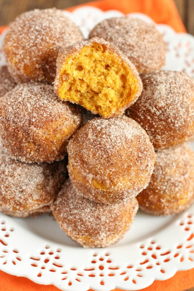 Baked pumpkin donut holes coated with cinnamon and sugar. These make ...