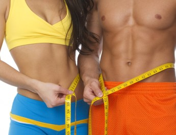 fit torso of man and woman measuring waist
