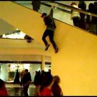 Dumb Kid Falls Hard Off Escalator, Deserves It