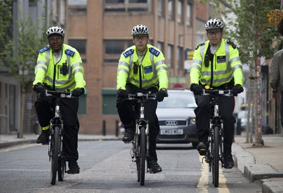 3 officers riding on road