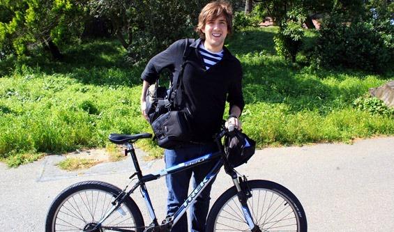 Me posing next to my rented blue Trek Mountain bike