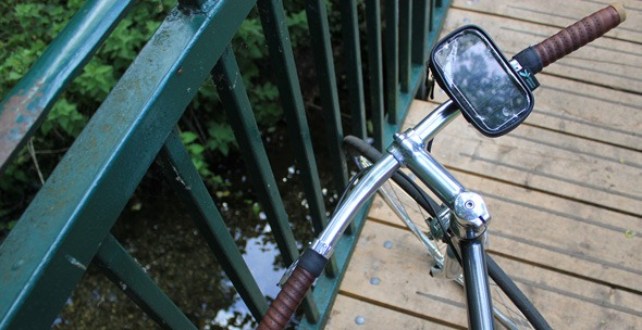 Ultimatemobiles iPhone bike mount on handlebars with view of Wandle River behind
