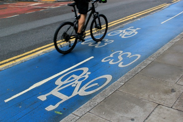 Cyclist riding across Cycle Superhighway 3