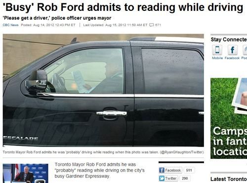 Mayor reading and driving