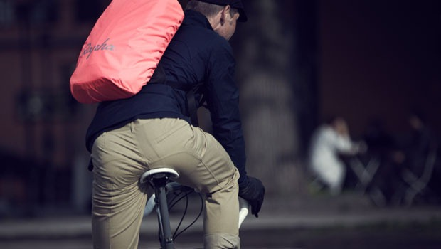Rapha backpack seen from the rear view ith the pink cover on