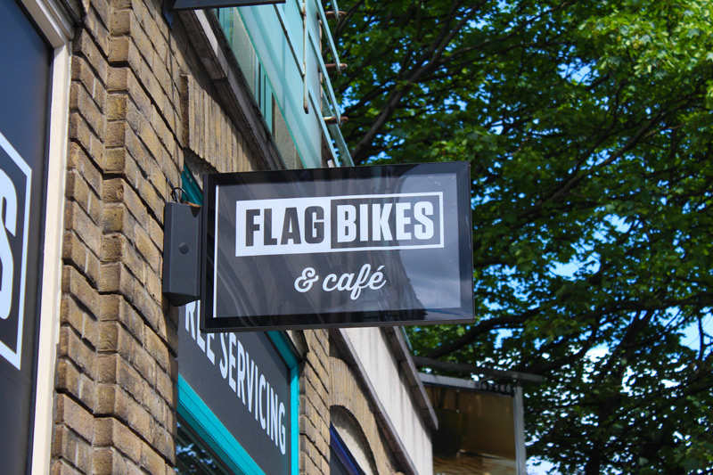 Flag bikes sign outside the store