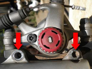 Disc brake calliper removal