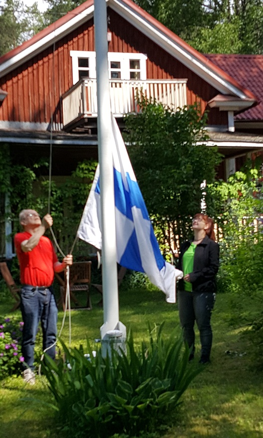 putting up the Finnish flag