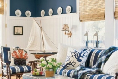 blue and white bech house style living room with es and fun details like crab pillow