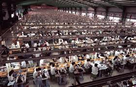 Factory filled with workers and sawing machines