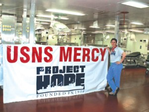 Carole Snyder, a US Army  veteran, a RN, and PIH Health's Program Manager of Emergency Preparedness, onboard the USNS Mercy. Snyder travelled on the Mercy to Sumatra after the earthquake, helping-injured patients, and providing humanitarian care.