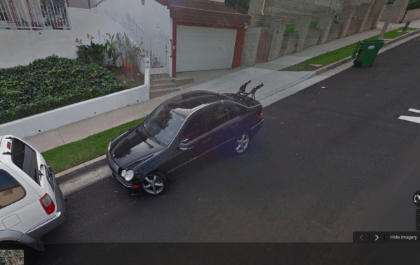 A Feb. 2015 Google street view picture of Ron Wilson's house with Dir. Vasquez car parked in front.