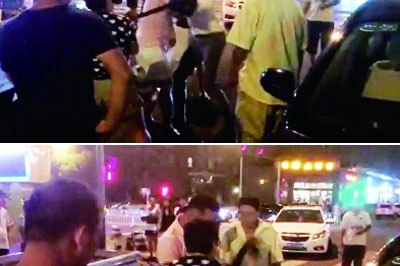 BMW driver beats foreigner with belt in Beijing