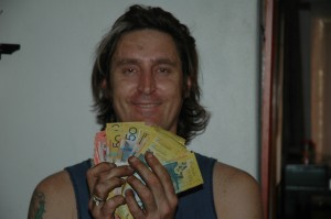 Billy (LostTreasure.com.au Author) Holding the Found Cache of Money